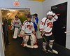 Baldwinsville Bees players Joe Glamos (18), goalie Jeremy Rappard (30) and goalie Josh Smith (1) head to the ice before playing the Ithaca Little Red in a NYSPHSAA Ice Hockey Championship Regional Playoff game at The Rink in Ithaca, New York on Saturday, March 7, 2015.  Baldwinsville won 2-1..