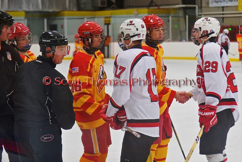 Captains for the Baldwinsville Bees and Ithaca Little Red shake hands before a NYSPHSAA Ice Hockey Championship Regional Playoff game at The Rink in Ithaca, New York on Saturday, March 7, 2015.  Baldwinsville won 2-1..