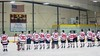 Baldwinsville Bees lined up for the National Anthem before playing the Ithaca Little Red in a NYSPHSAA Ice Hockey Championship Regional Playoff game at The Rink in Ithaca, New York on Saturday, March 7, 2015.  Baldwinsville won 2-1..
