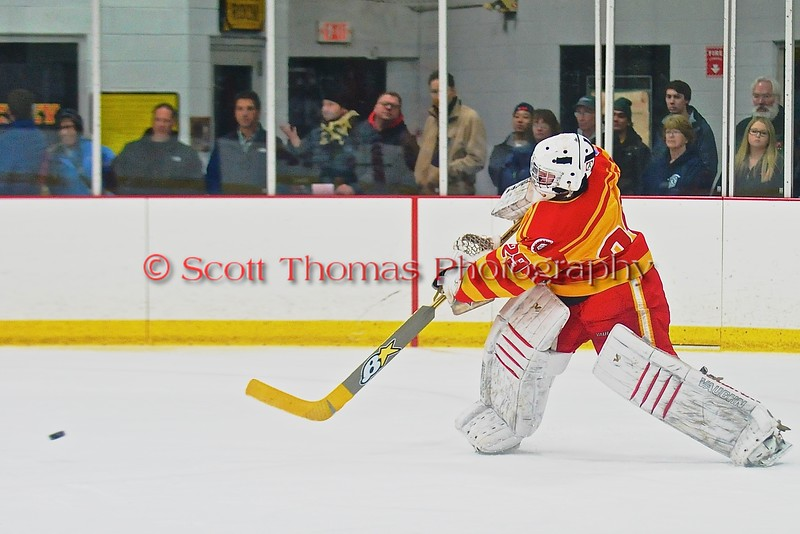 Ithaca Little Red goalie Griffin Varricchio (29) passes the pic up ice against the Baldwinsville Bees in a NYSPHSAA Ice Hockey Championship Regional Playoff game at The Rink in Ithaca, New York on Saturday, March 7, 2015.  Baldwinsville won 2-1..