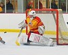 Ithaca Little Red goalie Griffin Varrichio (29) tracking a shot by a Baldwinsville Bees player in a NYSPHSAA Ice Hockey Championship Regional Playoff game at The Rink in Ithaca, New York on Saturday, March 7, 2015.  Baldwinsville won 2-1..