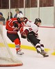 Baldwinsville Bees Adam Tretowicz (21) and Syracuse Cougars Colby Skrupa (20) go after the puck at Meachem Ice Rink in Syracuse, New York on Friday, January 16, 2015.  Syracuse won 3-1.