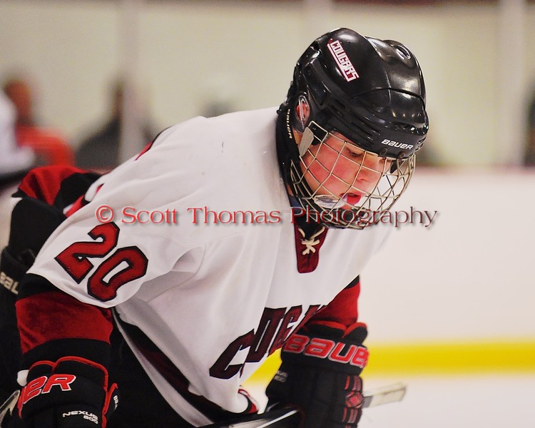 Syracuse Cougars Colby Skrupa (20) before a face-off against the Baldwinsville Bees at Meachem Ice Rink in Syracuse, New York on Friday, January 16, 2015.  Syracuse won 3-1.
