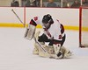 Syracuse Cougars goalie Sam Walsh (28) makes a stick save against the Baldwinsville Bees at Meachem Ice Rink in Syracuse, New York on Friday, January 16, 2015.  Syracuse won 3-1.