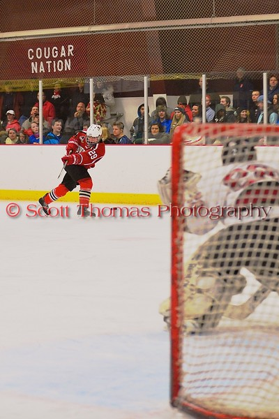 Baldwinsville Bees Matt Abbott (29) fires a shot at the Syracuse Cougars net at Meachem Ice Rink in Syracuse, New York on Friday, January 16, 2015.  Syracuse won 3-1.