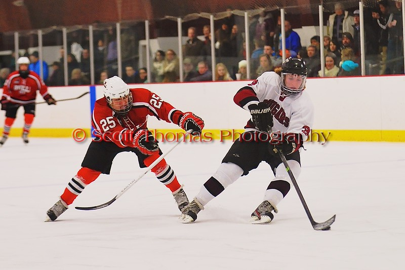 Baldwinsville Bees Andrew Starrantino (25) forechecking Syracuse Cougars Sean Eccles (3) at Meachem Ice Rink in Syracuse, New York on Friday, January 16, 2015.  Syracuse won 3-1.