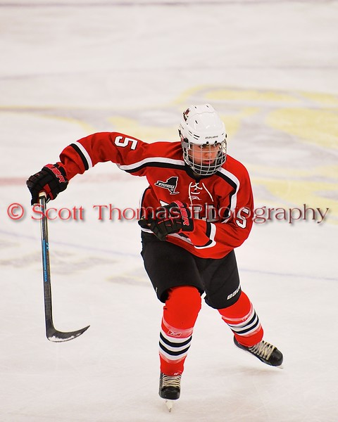 Baldwinsville Bees Isaiah Pompo (5) on the ice against the West Genesee Wildcats at Shove Park in Camillus, New York on Friday, January 9, 2015. Game ended in a 3-3 tie.