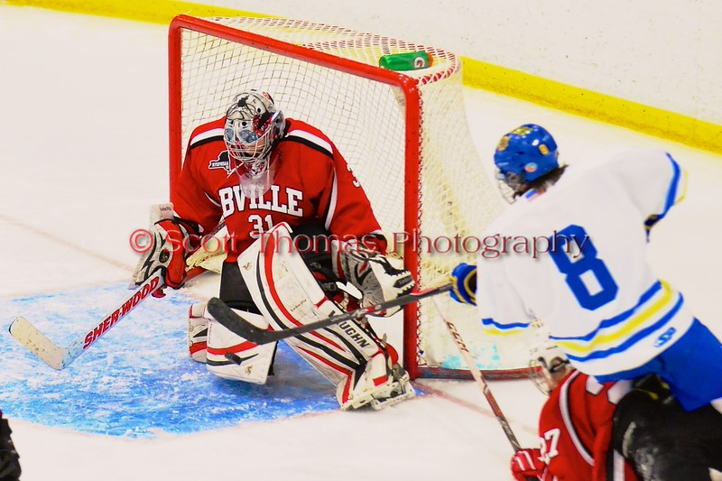 Baldwinsville Bees goalie Matt Sabourin (31) makes a save on West Genesee Wildcats Ryan McDonald (8) at Shove Park in Camillus, New York on Friday, January 9, 2015. Game ended in a 3-3 tie.
