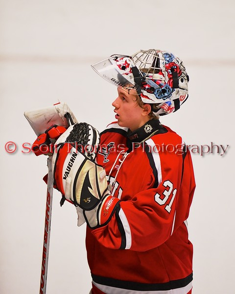 Baldwinsville Bees goalie goalie Matt Sabourin (31) during a timeout against the West Genesee Wildcats at Shove Park in Camillus, New York on Friday, January 9, 2015. Game ended in a 3-3 tie.