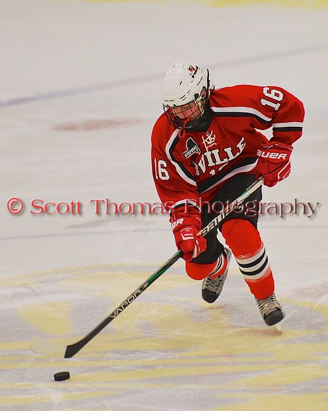 Baldwinsville Bees Carson Hayes (16) with the puck against the West Genesee Wildcats at Shove Park in Camillus, New York on Friday, January 9, 2015. Game ended in a 3-3 tie.