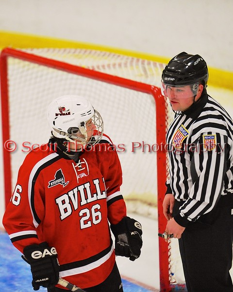 Baldwinsville Bees Kyle Lindsay (26) talks with a referee during a stoppage of play against the West Genesee Wildcats at Shove Park in Camillus, New York on Friday, January 9, 2015. Game ended in a 3-3 tie.