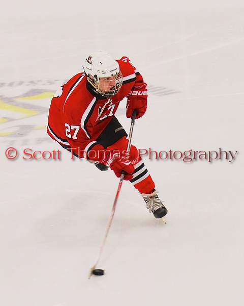 Baldwinsville Bees Matt Metcalf (27) leans into a shot at the West Genesee Wildcats net at Shove Park in Camillus, New York on Friday, January 9, 2015. Game ended in a 3-3 tie.