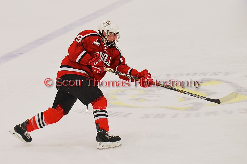 Baldwinsville Bees Matt Abbott (29) follows through on a shot at he West Genesee Wildcats net at Shove Park in Camillus, New York on Friday, January 9, 2015. Game ended in a 3-3 tie.