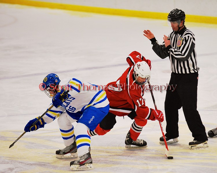 Baldwinsville Bees James Pelcher (17) wins a face-off against West Genesee Wildcats Carson Hayes (16) at Shove Park in Camillus, New York on Friday, January 9, 2015. Game ended in a 3-3 tie.