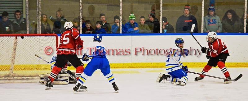 Baldwinsville Bees Kyle Lindsay (26) scores a goal against the West Genesee Wildcats to give the Bees a 3-2 lead at Shove Park in Camillus, New York on Friday, January 9, 2015. Game ended in a 3-3 tie.