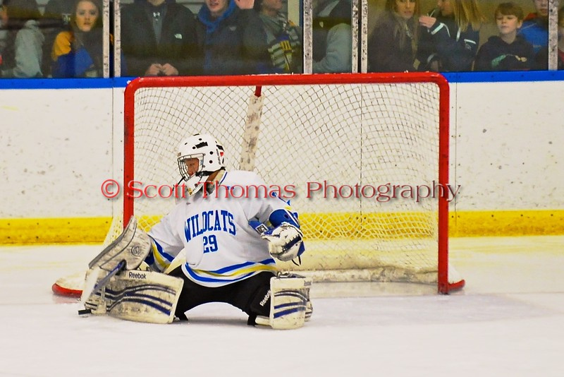 West Genesee Wildcats goalie Sammy Colabufo (29) makes a save on a shot by a Baldwinsville Bees player at Shove Park in Camillus, New York on Friday, January 9, 2015. Game ended in a 3-3 tie.