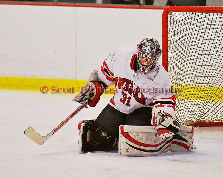 Baldwinsville Bees goalie Matt Sabourin (31) makes a glove save against the Fayetteville-Manlius Hornets at the Greater Baldwinsville Ice Arena in Baldwinsville, New York on Tuesday January 6, 2015.  Baldwinsville won 6-1.