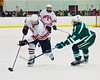 Baldwinsville Bees Tanner McCaffrey (2) stick handles around Fayetteville-Manlius Hornets Erik Badger (11) at the Greater Baldwinsville Ice Arena in Baldwinsville, New York on Tuesday January 6, 2015.  Baldwinsville won 6-1.