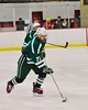 Fayetteville-Manlius Hornets Zack Wisby (77) with the puck against the Baldwinsville Bees at the Greater Baldwinsville Ice Arena in Baldwinsville, New York on Tuesday January 6, 2015.  Baldwinsville won 6-1.