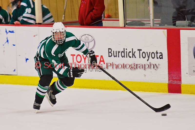 Fayetteville-Manlius Hornets Garrett Zogby (2) with the puck against the Baldwinsville Bees at the Greater Baldwinsville Ice Arena in Baldwinsville, New York on Tuesday January 6, 2015.  Baldwinsville won 6-1.