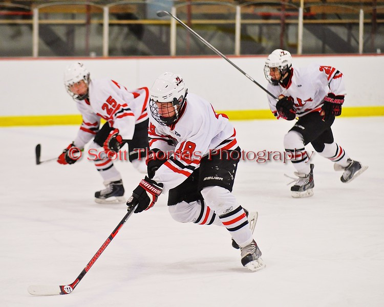Baldwinsville Bees Joe Glamos (18) leads the rush against the Fayetteville-Manlius Hornets at the Greater Baldwinsville Ice Arena in Baldwinsville, New York on Tuesday January 6, 2015.  Baldwinsville won 6-1.