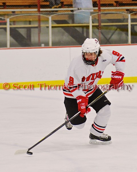 Baldwinsville Bees Jacob Norton (9) with the puck against the Fayetteville-Manlius Hornets at the Greater Baldwinsville Ice Arena in Baldwinsville, New York on Tuesday January 6, 2015.  Baldwinsville won 6-1.