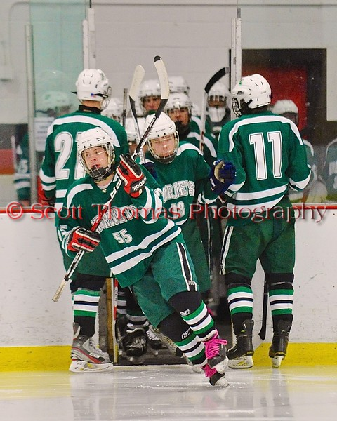 Fayetteville-Manlius Hornets Andrew Coughlin (55) leads his team on the ice against the Baldwinsville Bees before the start of the second period at the Greater Baldwinsville Ice Arena in Baldwinsville, New York on Tuesday January 6, 2015.  Baldwinsville won 6-1.
