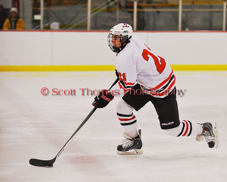Baldwinsville Bees Adam Tretowicz (21) bringing the puck up ice against the Fayetteville-Manlius Hornets at the Greater Baldwinsville Ice Arena in Baldwinsville, New York on Tuesday January 6, 2015.  Baldwinsville won 6-1.