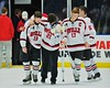 Baldwinsville Bees James Pelcher (17) and Joe Glamos (18) help injured teammate, Adam Tretowicz (21), on to the ice after playing the McQuaid Black Knights in NYSPHSAA Division I Boys Hockey Championships at the Utica Memorial Auditorium in Utica, New York on Sunday, March 15, 2015.