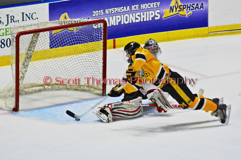 McQuaid Black Knights Jack Dungan (8) about to backhand the puck past Baldwinsville Bees goalie Matt Sabourin (31) in NYSPHSAA Division I Boys Hockey Championships at the Utica Memorial Auditorium in Utica, New York on Sunday, March 15, 2015.  McQuaid won 6-2.