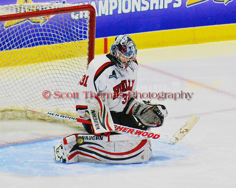 Baldwinsville Bees goalie Matt Sabourin (31) makes a save against the McQuaid Black Knights in NYSPHSAA Division I Boys Hockey Championships at the Utica Memorial Auditorium in Utica, New York on Sunday, March 15, 2015.  McQuaid won 6-2.