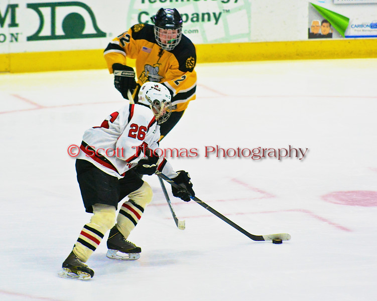 Baldwinsville Bees Kyle Lindsay (26) heads to the net against the McQuaid Black Knights in NYSPHSAA Division I Boys Hockey Championships at the Utica Memorial Auditorium in Utica, New York on Sunday, March 15, 2015.  McQuaid won 6-2.