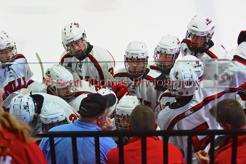 Baldwinsville Bees Head Coach Mark Lloyd talks with his team before the start of the second period against the McQuaid Black Knights in NYSPHSAA Division I Boys Hockey Championships at the Utica Memorial Auditorium in Utica, New York on Sunday, March 15, 2015.  McQuaid won 6-2.
