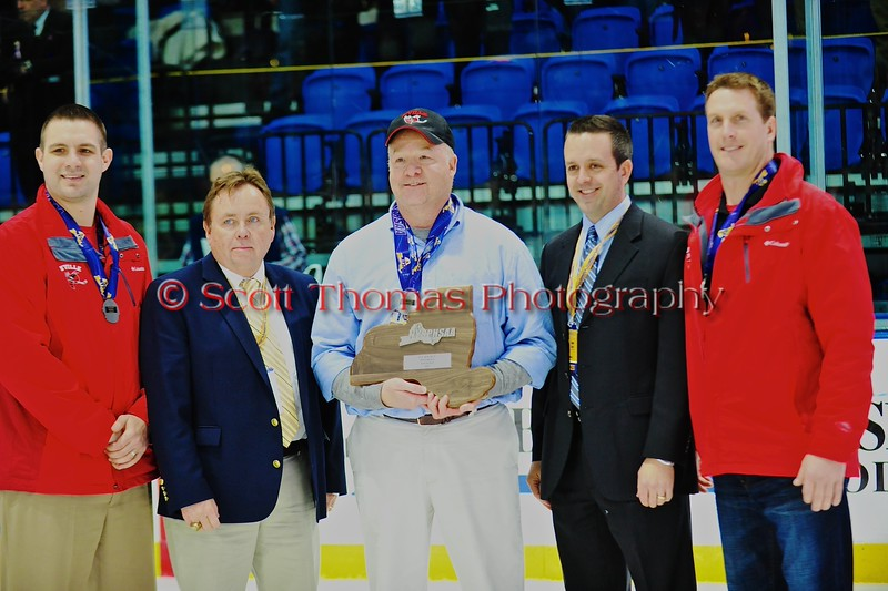 Baldwinsville Bees coaches Mike Pope, Mark Lloyd and Glenn McCaffrey after receiving the Finals plaque after the game against the McQuaid Black Knights in NYSPHSAA Division I Boys Hockey Championships at the Utica Memorial Auditorium in Utica, New York on Sunday, March 15, 2015.