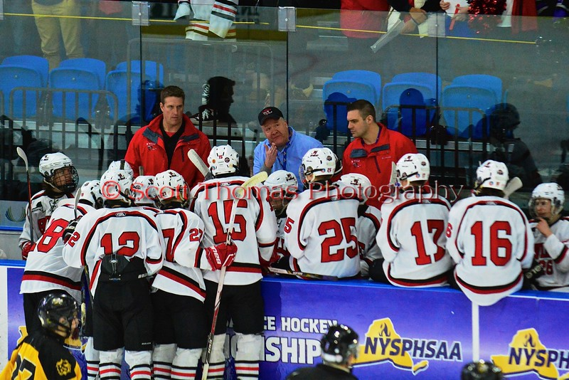 Baldwinsville Bees Head Coach Mark Lloyd talks to his players during a time out during the game against the McQuaid Black Knights in NYSPHSAA Division I Boys Hockey Championships at the Utica Memorial Auditorium in Utica, New York on Sunday, March 15, 2015.  McQuaid won 6-2.
