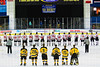 Baldwinsville Bees and McQuaid Black Knights players on the ice for the National Anthem before the NYSPHSAA Division I Boys Hockey Championship game at the Utica Memorial Auditorium in Utica, New York on Sunday, March 15, 2015.