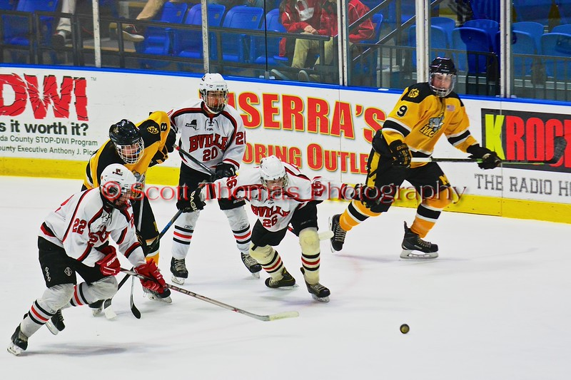 Baldwinsville Bees Matt Monaco (22), Ryan Gebhardt (20) and Kyle Lindsay (26) scramble for the puck against the McQuaid Black Knights in NYSPHSAA Division I Boys Hockey Championships at the Utica Memorial Auditorium in Utica, New York on Sunday, March 15, 2015.  McQuaid won 6-2.
