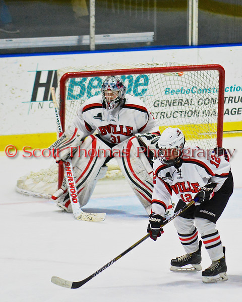 Baldwinsville Bees Connor Carhart (12) and goalie Matt Sabourin (31) await a face-off against the McQuaid Black Knights in NYSPHSAA Division I Boys Hockey Championships at the Utica Memorial Auditorium in Utica, New York on Sunday, March 15, 2015.  McQuaid won 6-2.