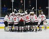 Baldwinsville Bees players huddle up before taking on the McQuaid Black Knights in the NYSPHSAA Division I Boys Hockey Championship game at the Utica Memorial Auditorium in Utica, New York on Sunday, March 15, 2015.