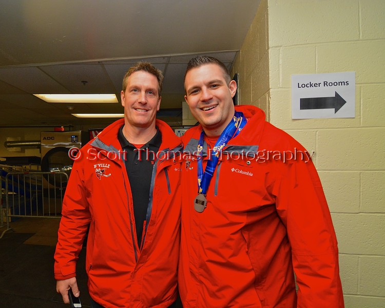 Baldwinsville Bees Assistant Coaches Glenn McCaffrey and Mike Pope after the game with the McQuaid Black Knights in NYSPHSAA Division I Boys Hockey Championships at the Utica Memorial Auditorium in Utica, New York on Sunday, March 15, 2015.
