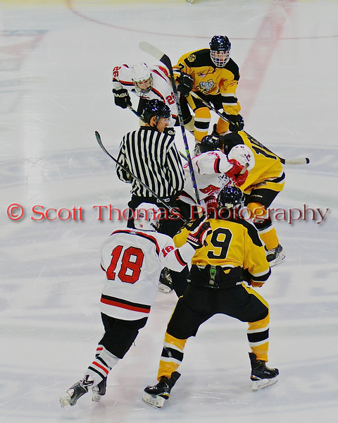 Baldwinsville Bees and McQuaid Black Knights face-off to start the second period in NYSPHSAA Division I Boys Hockey Championships at the Utica Memorial Auditorium in Utica, New York on Sunday, March 15, 2015.  McQuaid won 6-2.