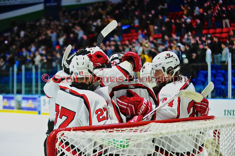 Baldwinsville Bees players huddle together after playing the McQuaid Black Knights in NYSPHSAA Division I Boys Hockey Championship game at the Utica Memorial Auditorium in Utica, New York on Sunday, March 15, 2015.  McQuaid won 6-2.