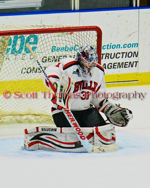 Baldwinsville Bees goalie Matt Sabourin (31) makes a pad save against the McQuaid Black Knights in NYSPHSAA Division I Boys Hockey Championships at the Utica Memorial Auditorium in Utica, New York on Sunday, March 15, 2015.  McQuaid won 6-2.