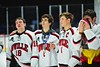 Baldwinsville Bees Joe Glamos (18), Adam Tretowicz (21), James Pelcher (17) and Matt Abbott (29) after playing the McQuaid Black Knights in NYSPHSAA Division I Boys Hockey Championships at the Utica Memorial Auditorium in Utica, New York on Sunday, March 15, 2015.