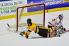 McQuaid Black Knights Jack Dungan (8) puts the puck in the net behind Baldwinsville Bees goalie Matt Sabourin (31) in NYSPHSAA Division I Boys Hockey Championships at the Utica Memorial Auditorium in Utica, New York on Sunday, March 15, 2015.  McQuaid won 6-2.