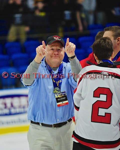 Baldwinsville Bees Head Coach Mark Lloyd acknowledges the students, parents and fans after the game against the McQuaid Black Knights in NYSPHSAA Division I Boys Hockey Championships at the Utica Memorial Auditorium in Utica, New York on Sunday, March 15, 2015.