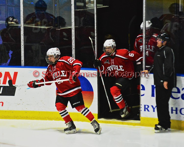 Baldwinsville Bees Andrew Starrantino (25) and Josh Racha (6) hit the ice before playing the Saratoga Springs Blue Streaks in NYSPHSAA Division I Boys Hockey Championships at the Utica Memorial Auditorium in Utica, New York on Saturday, March 14, 2015.
