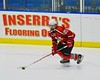 Baldwinsville Bees Matt Metcalf (27) with the puck against the Saratoga Springs Blue Streaks in NYSPHSAA Division I Boys Hockey Championships at the Utica Memorial Auditorium in Utica, New York on Saturday, March 14, 2015.  Baldwinsville won 2-1 in overtime.
