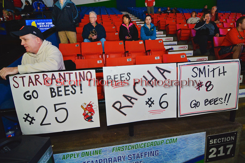 Baldwinsville Bees signs for Andrew Starrantino (25), Josh Racha (6) and Riley Smith (8) at the Utica Memorial Auditorium in Utica, New York on Saturday, March 14, 2015.