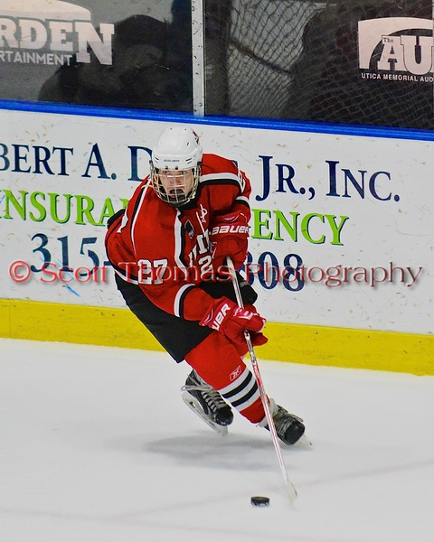 Baldwinsville Bees Matt Metcalf (27) looking to make a play against the Saratoga Springs Blue Streaks in NYSPHSAA Division I Boys Hockey Championships at the Utica Memorial Auditorium in Utica, New York on Saturday, March 14, 2015.  Baldwinsville won 2-1 in overtime.